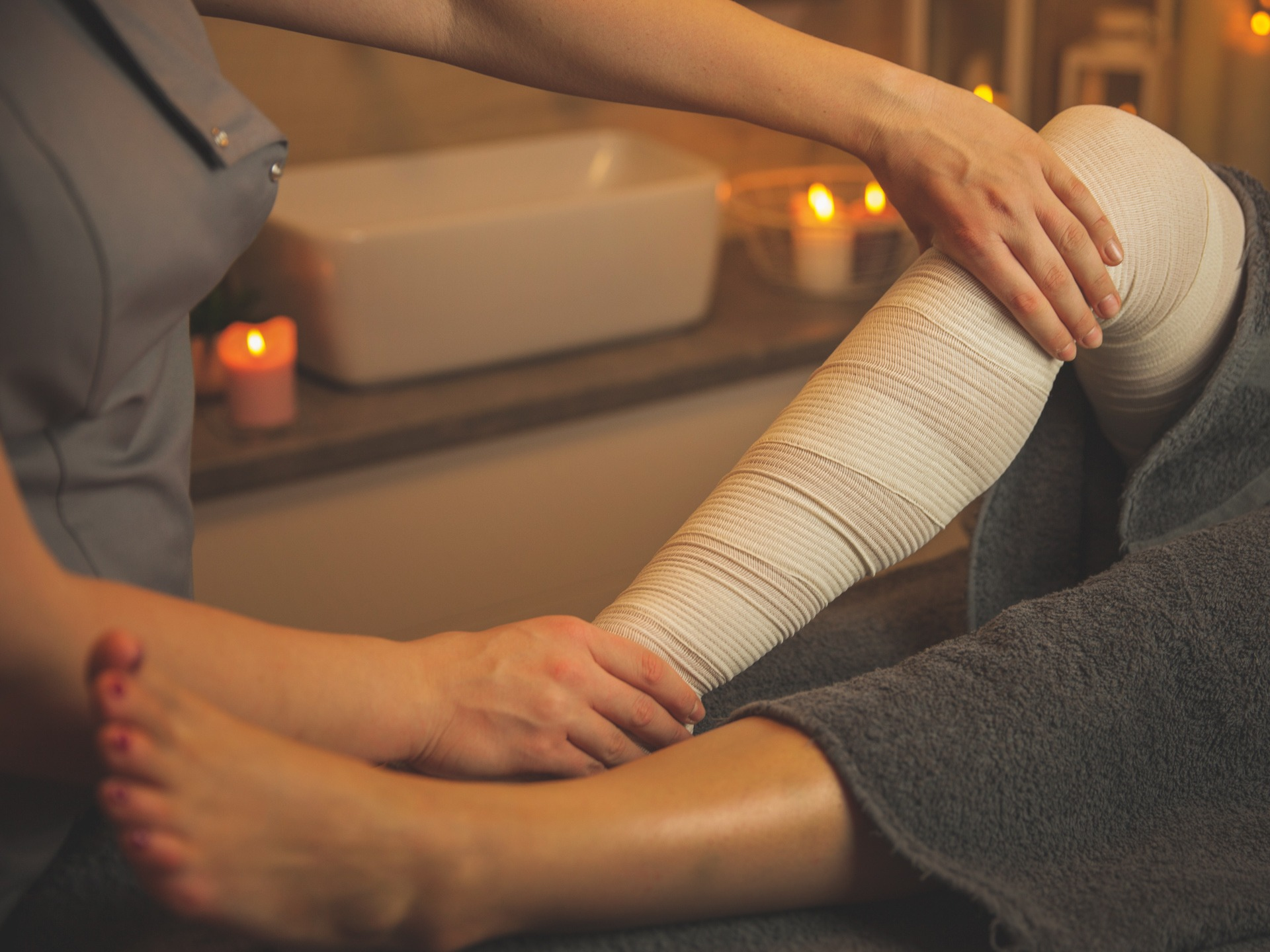 bandages legs lymphatic drainage massage for a patient with swel