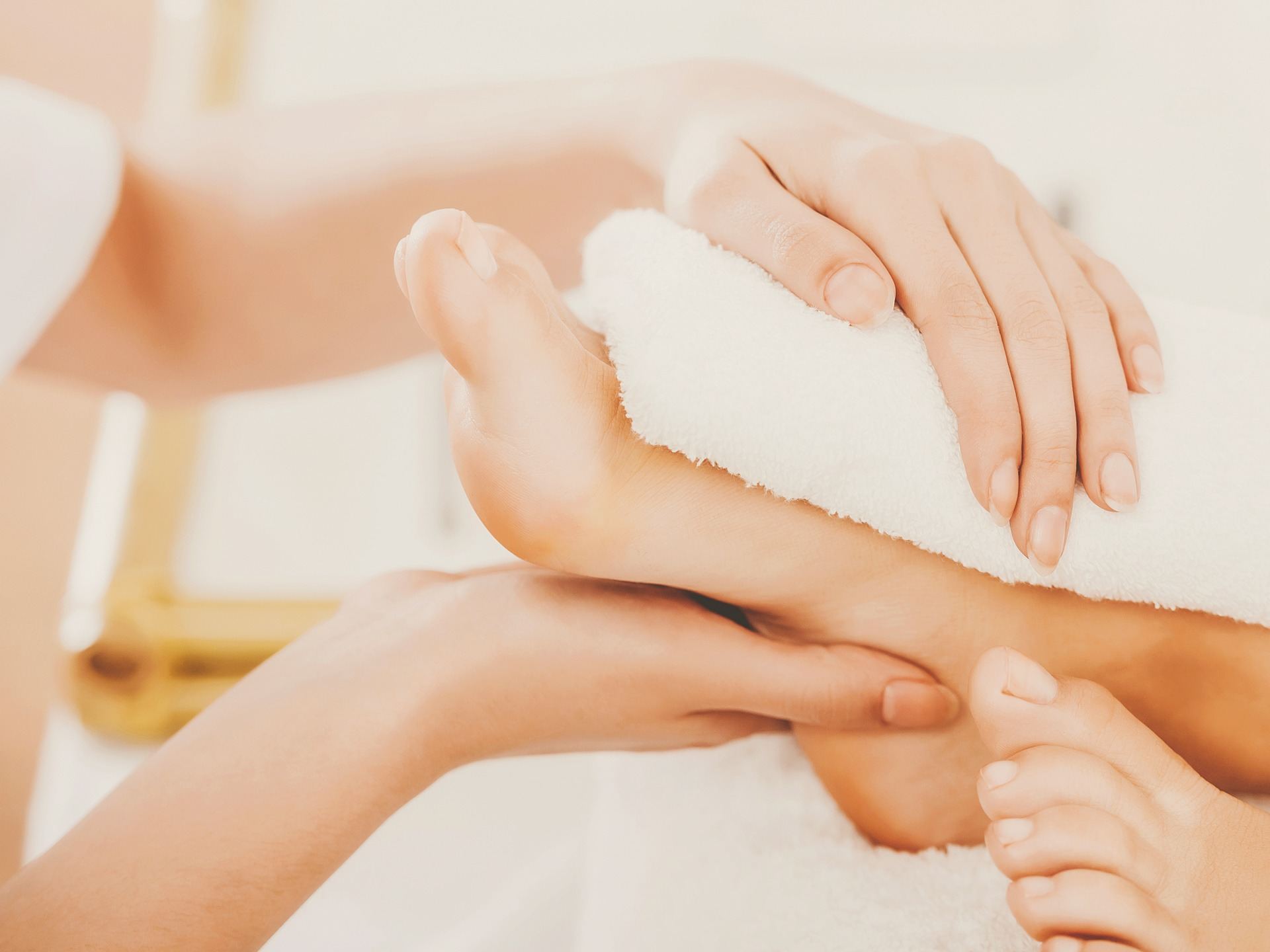Beautiful Clean Female Legs in Spa Composition. Pedicure for Happy Client. Groomed Legs in Soft White Towel. Young Girl Does Pedicure in Beauty Salon. Concept of Beauty and Health.